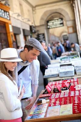 Tourists in Madrid walking by flea market