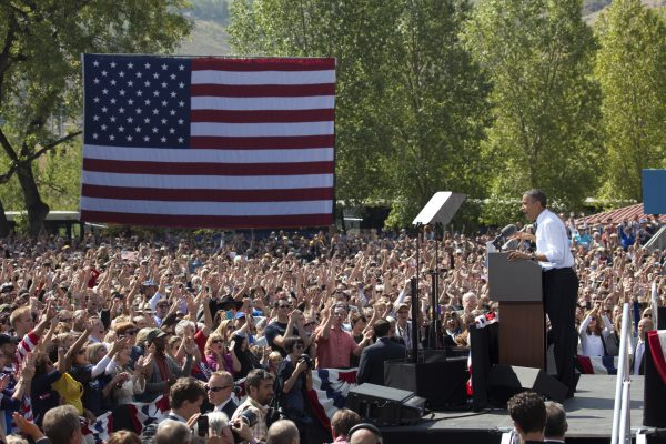 Golden, Colorado, U.S.A. - September 13, 2012: In Golden's Lions Park, a large and diverse crowd of people has gathered to listen, applause and cheer President Barack Obama who speaks about his plans for the future.